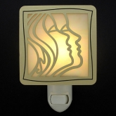 "Artists throughout time have produced works that feature the human face, such as Kyle's ""Faces in Profile"" stain glass night light."